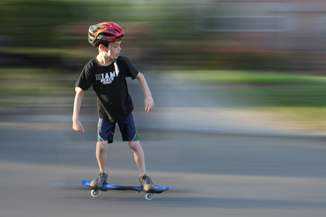 boy riding a ripstik
